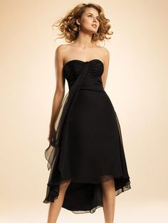 Black just-past-knee-length dress with lightly sequined bodice and flowing skirt.  Bridesmaid Wedding Dresses-Style BR067