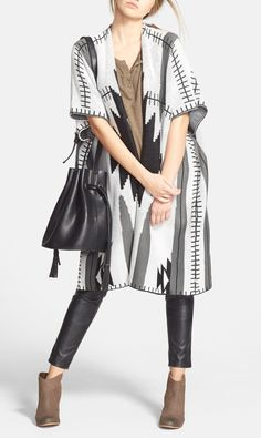 The slouchy, chic bucket bag complements this fall outfit fabulously.