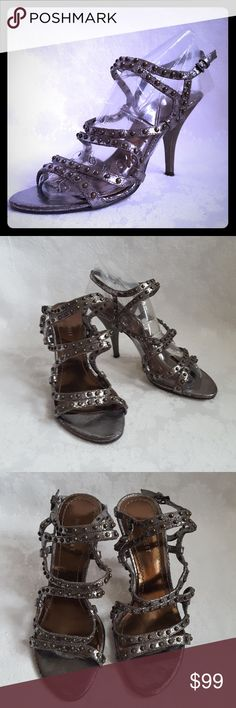"""Nine West Strappy Gunmetal Leather Sandal Heel Nine West gunmetal or pewter leather strappy high heel sandal with 3 3/4"""" heels. Brown metal button studs. Dark brass, copper, gold undertones. Adjustable ankle strap with buckle. Style is """"MOUTON"""".   Very good used condition. Smoke free and pet free home.   Check out my other listings - 100's of 👠shoes👠, 👢boots👢 and 👜bags👜. Bundle 2 or more and save money!💲💰 Nine West Shoes Heels"""