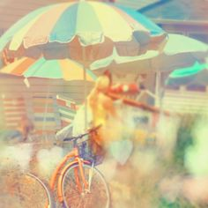 Items similar to Beach Photograph - Seaside Town Print - soft surreal summer decor photo oceanside peach orange pastel beach umbrella photography on Etsy