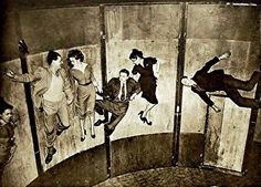 Centrifugal force pins these patrons while they appear to defy gravity on the spinning Ride-A-Wall amusement at Bertram Mills Circus, Olympia, London, 1951.
