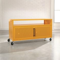Sauder Soft Modern TV Stand in Yellow