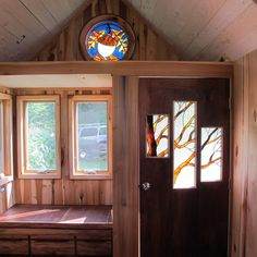 Tiny home with stained glass windows. Love!