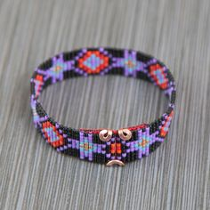 This Edgewood Bead Loom bracelet was inspired by all the beautiful Native and Latin American patterns I see around me in Albuquerque, New Mexico. As with all my pieces, Ive created it on a bead loom with great care and attention to detail. IMPORTANT NOTE: Please measure your wrist carefully before order placement, to ensure a proper fit. These bracelets are not adjustable.  The beads used in this piece are my favorite - high quality glass Japanese Delicas, much more even and consistent than…