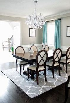 Dining Room Decor Gray elegant furniture, a stylish chandelier, an eye-grabbing piece of