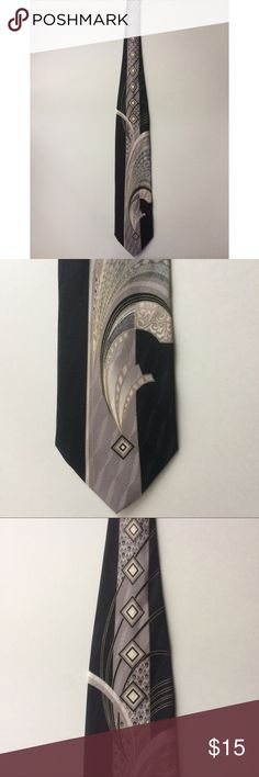 Enrico Venturi Black White Whimsical 59 1/2 inches This Enrico Venturi Black White Whimsical 59 1/2 inches is perfect for work or any special occasion. This tie is 100% silk! Enrico Venturi Accessories Ties