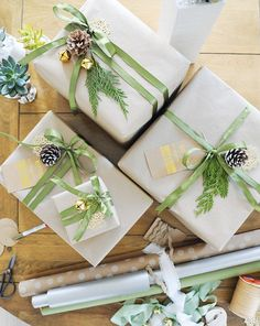 Light Green & Linen Green is a signature color of the holidays, but if you're looking to tweak your palette while still staying true to seasonal hues, consider a lighter shade of green. Here, green silk ribbons and gilded accents look great next to understated kraft paper.