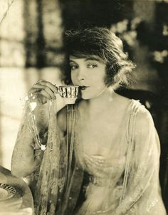 Way Down East (1920) Lillian Gish. Nice and simple an everyday picture, having the model lift her pinky whilst holding a tea pot gives her a more cheeky look as she is partially smiling with her mouth and eyes.