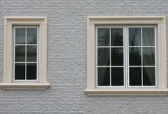 Concrete surrounds & stone moldings (concrete headers, & sills) can add elegance to any home or building. Stucco And Stone Exterior, Interior Windows, Window Frame Decor, Window Molding, Window Trim Exterior, Window Grill Design, Exterior Window Sill, Windows Exterior, Exterior Brick