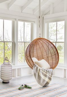 Hanging chair - Love the wicket of this chair for indoor or outdoor purposes. Love the white colour background rather than the warm yellow colour of the other chair.
