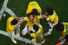 David Luiz of Brazil celebrates scoring his team's first goal with teammates during the 2014 FIFA World Cup Brazil round of 16 match between Brazil and Chile at Estadio Mineirao on June 28, 2014 in Belo Horizonte, Brazil. (Photo by Francois Xavier Marit - Pool/Getty Images)