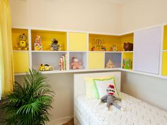 Cheery Storage    Bright yellow wraparound cabinets serve as a unique headboard in this contemporary kid's room. Open and closed cubbies allow for the child to display favorite toys or hide away treasured possessions.