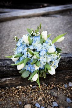 Simple and elegant bridal bouquet with white tulips.