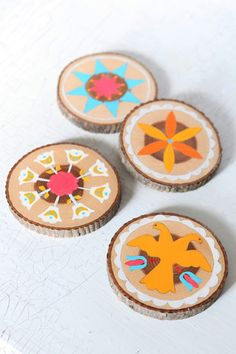 Wooden painted coasters (has link to tutorial, tutorial at http://www.designsponge.com/2010/11/diy-project-paint-by-number-hex-symbol-coasters.html)