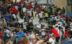 Fans clash during the UEFA EURO 2016 Group B match between England and Russia at Stade Velodrome on June 11, 2016 in Marseille, France.