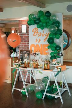 Baby Leo party candy bar Lion King theme 1st birthday party boy  photobooth backdrop jungle leaves balloons sweets table cupcake gingerbread cake pops