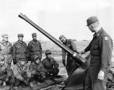 st Lieutenant Henry Pugh taking a class in the operation of a 40mm gun at a Korean training area, 17th March 1954.
