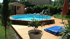 Qui a dit quune piscine hors-terre était moins beau Above Ground Pool Decks, In Ground Pools, Swimming Pool Photography, Outdoor Fireplace Patio, Swimming Pool Decks, Pool House Designs, Garden Tub, Pool Houses, 1