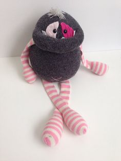 http://www.etsy.com/listing/175610514/smug-monster-plush-toy-upcycled-from?ref=shop_home_active_3