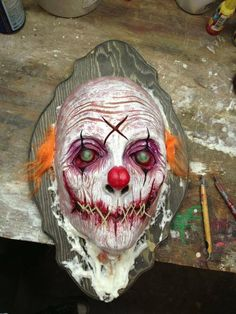Halloween creepy clown head on a plaque