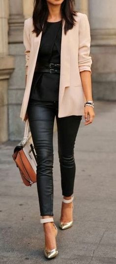 This one is a total love for Friday's working hours. We see a blush blazer worn atop black separates, featuring belted blouse and leather look skinny trousers. In love with cuffed shiny pumps.