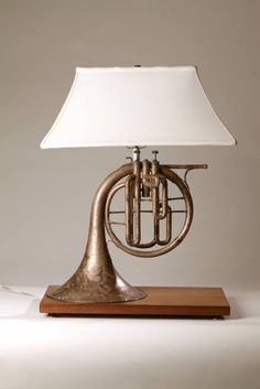 Made this lamp for my music room a few years ago. Used French horn from local … Made this lamp for my music room a few years ago. Used French horn from local antique store, old walnut plank and a shade from an old lamp that I had. Made the base to mirro Old Musical Instruments, Horn Instruments, Old Lamps, French Horn, Antique Stores, Lampshades, Lamp Makeover, Lighting Design, Lighting Ideas