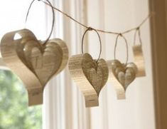 Recycled paper heart garland perfect for Valentine's Day. Decorate for a Valentines party with these. Book Crafts, Arts And Crafts, Diy Crafts, Craft Books, Paper Heart Garland, Paper Garlands, Diy Garland, Paper Ornaments, Hanging Paper Decorations