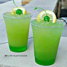 Green Goblin} 1oz peach or Green apple schnapps, 1oz Green Apple Vodka, 1oz Pineapple or Coconut rum, Midori, Sweet & sour, Pineapple juice