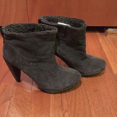 Nine West grey suede booties with embellishments Dark grey suede booties from Nine West. Has Sherpa lining inside. True to size. Rubber sole bottom for easy walking and has some silver speckled embezzlement on sides. Super cute for those winter nights. Nine West Shoes Ankle Boots & Booties