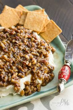 Topped with praline pecans this is the perfect sweet and salty combo - always popular at parties, French Quarter Pecan Cheese Spread Recipe