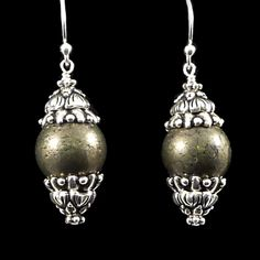 Show off your elaborately fancy side with these baroque-inspired earrings. These elegant dangles are made out of pyrite, lead-free pewter...