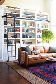 Spotlight on Layered Rugs Design Trend! Tons of design inspiration & examples of how to use layered rugs in any room in your home to add texture and style. Diy Interior, Living Room Interior, Living Room Furniture, Living Room Decor, Living Rooms, Living Room Bookcase, Modern Interior, Interior Decorating, Built In Shelves Living Room