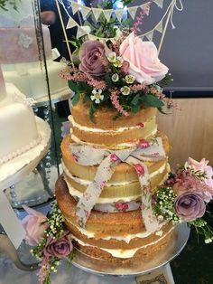 Naked wedding cake with fresh flowers by Corr's cakes