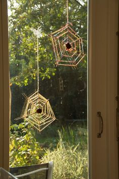 spiderwebs by oranjebehang, via Flickr