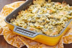 Spinach Artichoke Pasta that is surprisingly good for you with tons of veggies for under 350 calories. Made with a quick homemade sauce using spinach, artichoke hearts, and light cream cheese, this dish has so much flavor and is ready in just 30 minutes. Spinach Artichoke Pasta, Spinach Pasta Bake, Artichoke Recipes, Spinach Recipes, Artichoke Dip, Artichoke Hearts, Spinach Casserole, Easy Pasta Recipes, Sauce Recipes