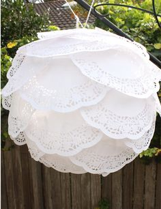 paper doily ball thing! SO much better than those overplayed Martha Stewart Poofs!