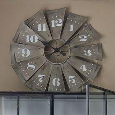 A rustic windmill clock.