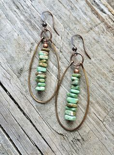 """Green turquoise magnesite chip dangles surrounded by hammered, antiqued copper hoops with copper accents. Approx 2"""" in length and very light weight."""