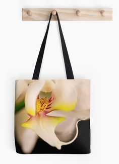 Orchid Tote bag by Gaye G Australia+Queensland+orchid+flower+bag+tote+product+accessory+accessories+women+woman+girls+black+pattern+yellow+white+cream+winter+summer+fall+autumn+spring+landscape+nature+redbubble+Gaye G Size is small, medium and large