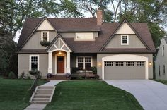 Beautiful home. I love the paint color. Colors are as follows: Trim/pillars: Ben Moore, elephant tusk. OC-8; Portico ceilings: Ben Moore, mid summer night. 2134-20 (dark stain); Siding: Ben Moore. Copley gray, Hc-104.