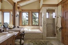 Martis Camp, Truckee, CA Master Bath limestone tile, Quartz counters  Bath  Craftsman by Brown Design Group