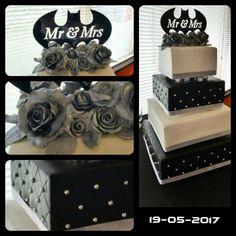 Wedding cake. Theme colors black, white and silver. Batman logo topper