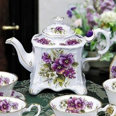 Violets. Purple is a color you see less on tea pots. I like this.