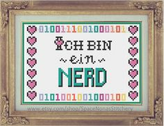 Ich Bin Ein Nerd - Includes Symbol on Color Pattern, and DMC key (message for Anchor) - 82 x 56 stitches - 5.8 x 3.9 inches - 14 count aida -