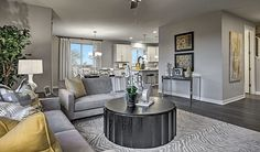 Muted yellow accents complement the neutral décor and paint in this sophisticated Henderson, NV, great room   Lillian plan by Richmond American