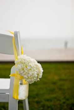 Mason Jars Filled with Flowers for The Wedding Chairs on the Aisle . . . BRILLIANT!