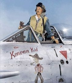 """Australian Pilot Officer Randall (Randy) Green, a former member of No. 23 (City of Brisbane) Squadron RAAF prepares for a mission against targets in North Korea with No 77 Squadron RAAF. The nose art on his aircraft reads """"the Korean Kid'. This Meteor, A77-316, was normally flown by Sergeant James C Kichenside, who served in Kimpo, Korea, from March until September 1952, completing 148 operational missions."""