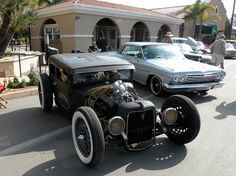 Just a car guy : Ricky Bobbys Rod Shop rat rod Frankenstein. I dig it. But it wasn't built by Garrett and Sons (name on the doors), it was made by RickyBobbyRodShop