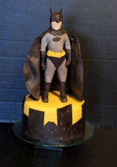 Choc Cake - fluffy peanut butter frosting and Cooked chocolate frosting between layers. Vanilla MM fondant cover and Modelling choc/MM fondant figure. .....Yeah I know.. Batman looks like he needs to go on a diet..... 2013