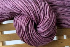 Hand dyed worsted weight yarn, 100% Superwash Merino Wool, purple - Orchid. $17.00, via Etsy.